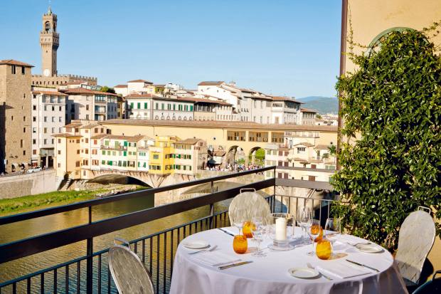 A private terrace overlooking Ponte Vecchio at Hotel Lungarno