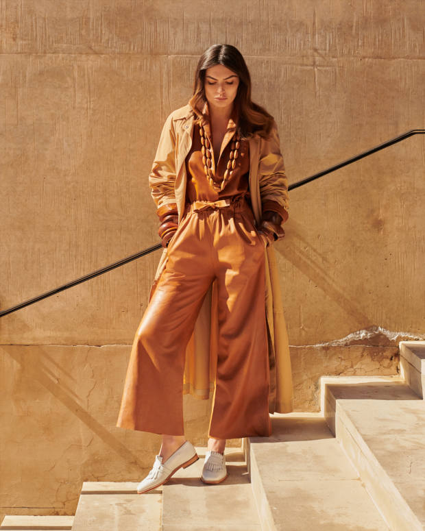 Salvatore Ferragamo technical poplin trench coat, £2,490, plongé nappa shirt, £3,415, and matching trousers, £4,245. Grenson calfskin Luna shoes, £235. Pebble London seed and ribbon necklace, £45 each, and wood bangles, from £25