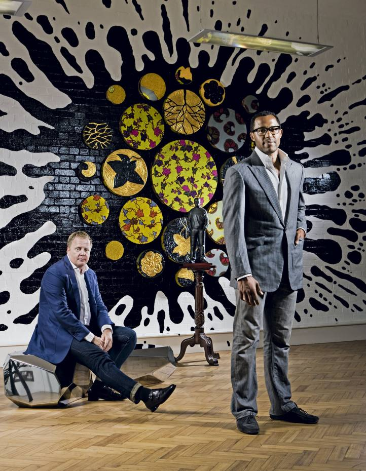 Gallerist Irving van Dijk, seated on RockFusion by Arik Levy, and James Zang at his Eagle Commodities office in London, with (on wall) Black Gold II by Yinka Shonibare and (between) a bronze by Tom Price