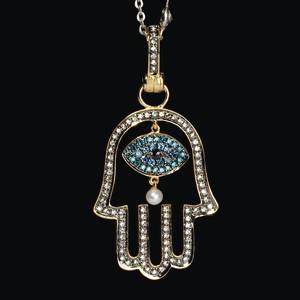 Annoushka gold, diamond and sapphire Hand of Fatima amulet, £1,800, on white-gold and sapphire Jasmine necklace, £995