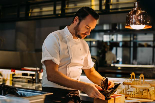Chef Jason Atherton at work in the kitchen at the hotel's King's Social House restaurant