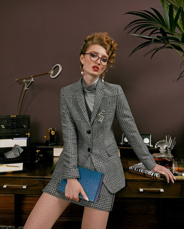Emporio Armani rhinestone-embellished wool jacket, £1,800, skirt, £720, foil and jersey bodysuit, £500, and crystal brooch, £310. Oroblu tights, £12.99. Lindberg glasses, £1,240. Alighieri gold-plated and pearl earrings, £420. Roche Bobois walnut desk, £4,290. Hermès metal and calfskin lamp, £7,100. Smythson calfskin stationery bureau, £1,595. L'Objet gold-plated letter opener, £115. El Casco gold-plated pencil sharpener, £449, and stapler, £115. Montblanc notebooks, from £75. William & Son leather clock, £1,025. Atlantis Crystal decanter, £200, and Richard Brendon tumbler, £75, from Bonadea. Caran d'Ache silver-plated fountain pens, from £688, and graphite pencils, £30 for four