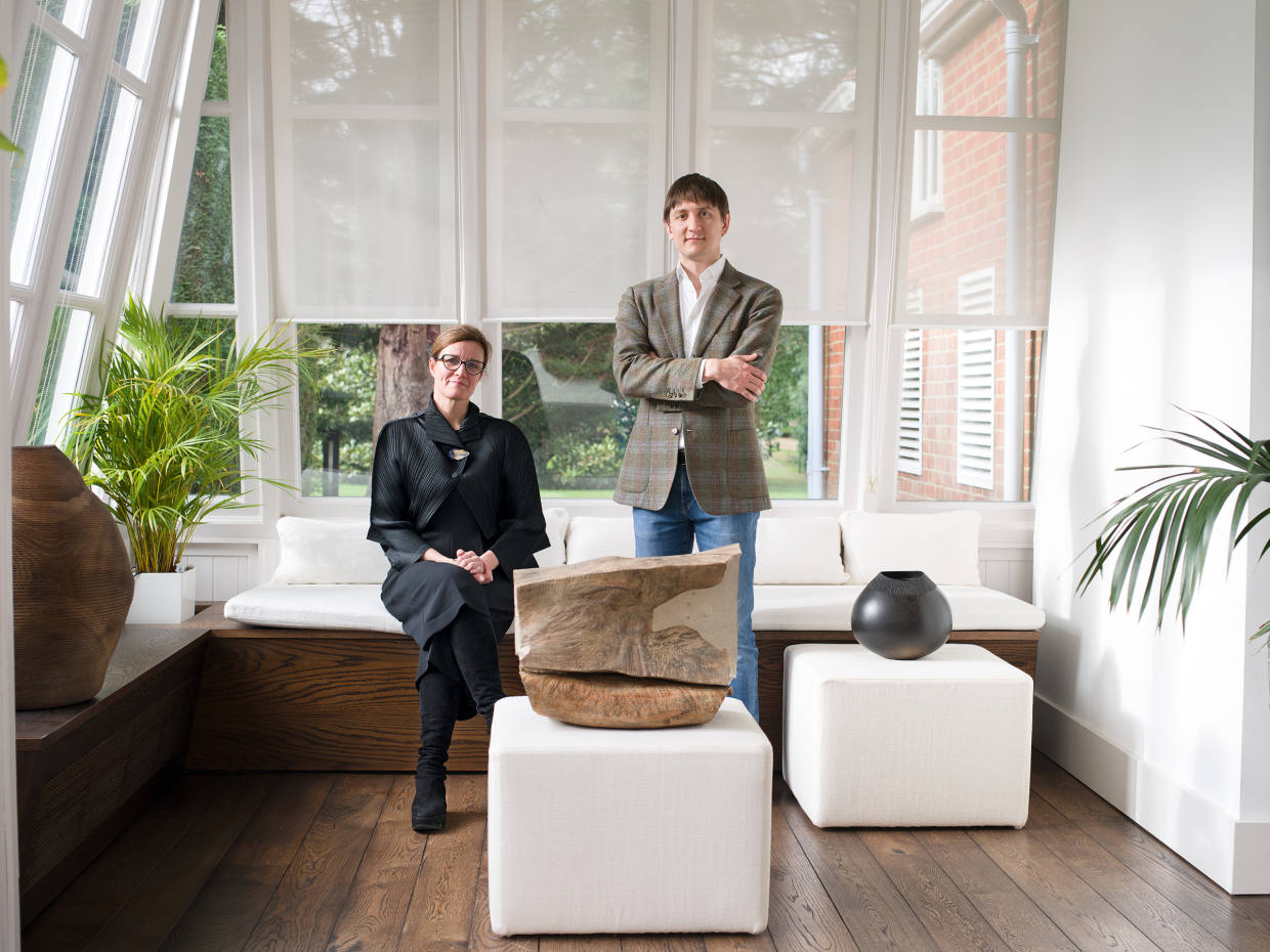 Gallerist Sarah Myerscough and venture capitalist Denis Shafranik with (from far left) lime-washed oak Vessel 4/230 by Ernst Gamperl, madrone burl hardwood Earthworks by Michael Peterson and ebonised oak Inner Rimmed Vessel ER3 by Liam Flynn