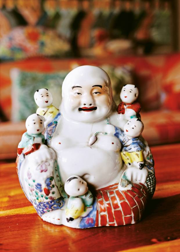 One of Fassett's collection of antique laughing Buddhas