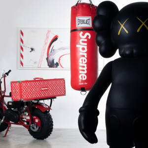"Clockwise from left: Coleman x Supreme Mini Moto CT200U ""Ride or Die"", 2017, estimate €3,000-€5,000. Louis Vuitton x Supreme skateboard trunk, 2017, estimate €50,000-€70,000. Futura 2000 untitled, 2016, acrylic and spray on canvas, estimate €15,000-€20,000. Everlast x Supreme boxing bag ""Lights Out"", estimate €4,000-€6,000. KAWS 4 Foot companion, Edition Medicom Toy, limited edition of 100, €40,000-€60,000. Gallery 1950 x Supreme ""Fuck Em!"" rug, estimate €1,000-€1,500"