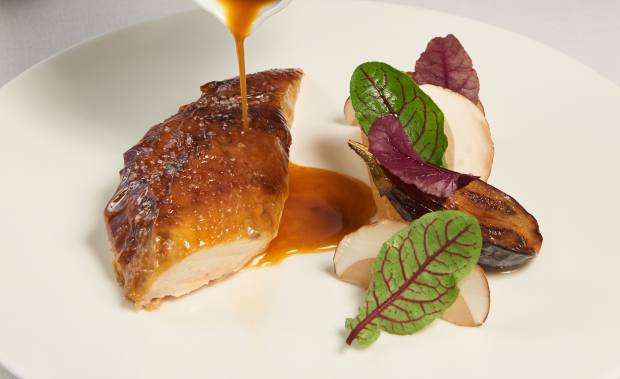 Landes roast chicken stuffed with ceps mushrooms and served with fondant aubergine