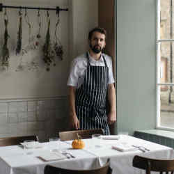 "Merlin Labron-Johnson at Osip, his intimate ""farm-to-table"" restaurant in Bruton"