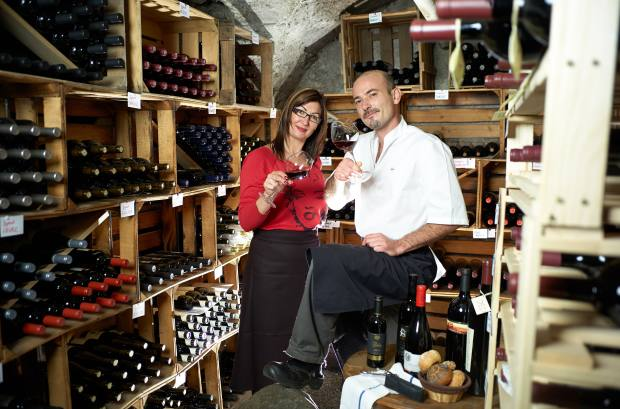 Chef Samuel Destaing and his wife in the restaurant's cellar