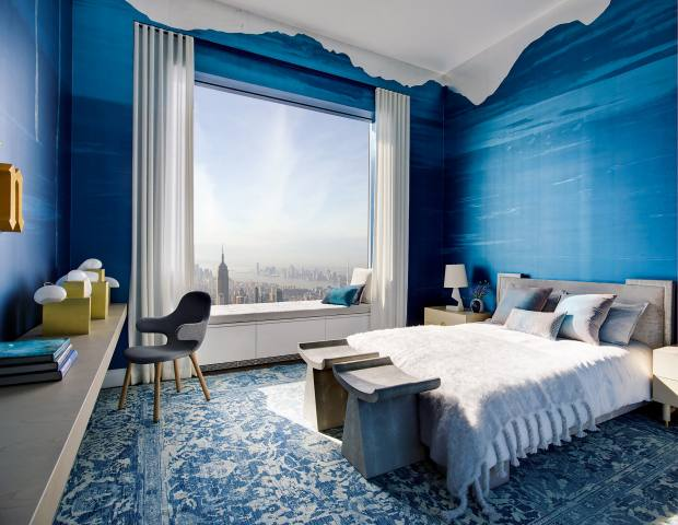 The inky-blue colour of the Manhattan mural, in the bedroom of the penthouse