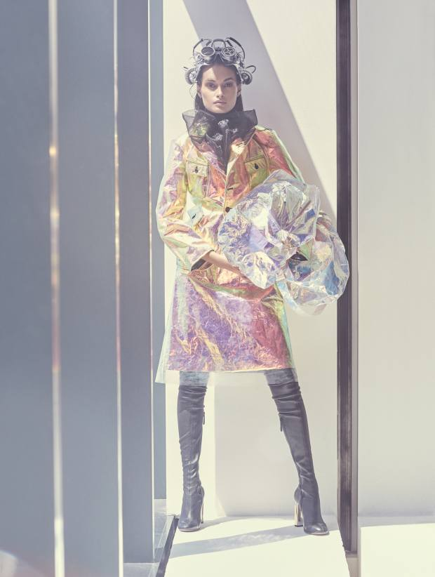 Maison Margiela refractive foil jacket, £428, and matching skirt, £189. Prada organza top, £545. Sies Marjan metal-effect canvas bag, £527. Alexander McQueen leather boots, £1,390. Helmet, stylist's own