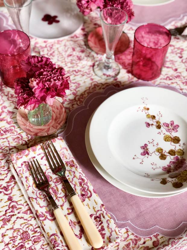 Cutter Brooks tablecloth, £175-£310, and napkin, £25, both by Zsuzsanna Nyul; Ivory Bistro cutlery, £60 for five-piece set; placemat, £25; 1920s Limoges-porcelain lunch service, similar services can be sourced; decoupage plate, £45; mouth-blown juice glass by Michael Ruh, £65; mouth-blown Syrian champagne flute, £15; and John Derian x Astier de Villatte Pelargonium saucer, £66
