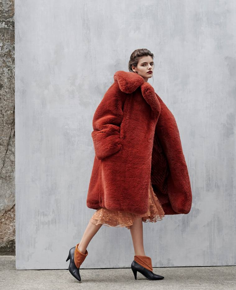 Givenchy faux-fur coat, £3,607, lace dress, £3,335, and calfskin and suede boots, £719