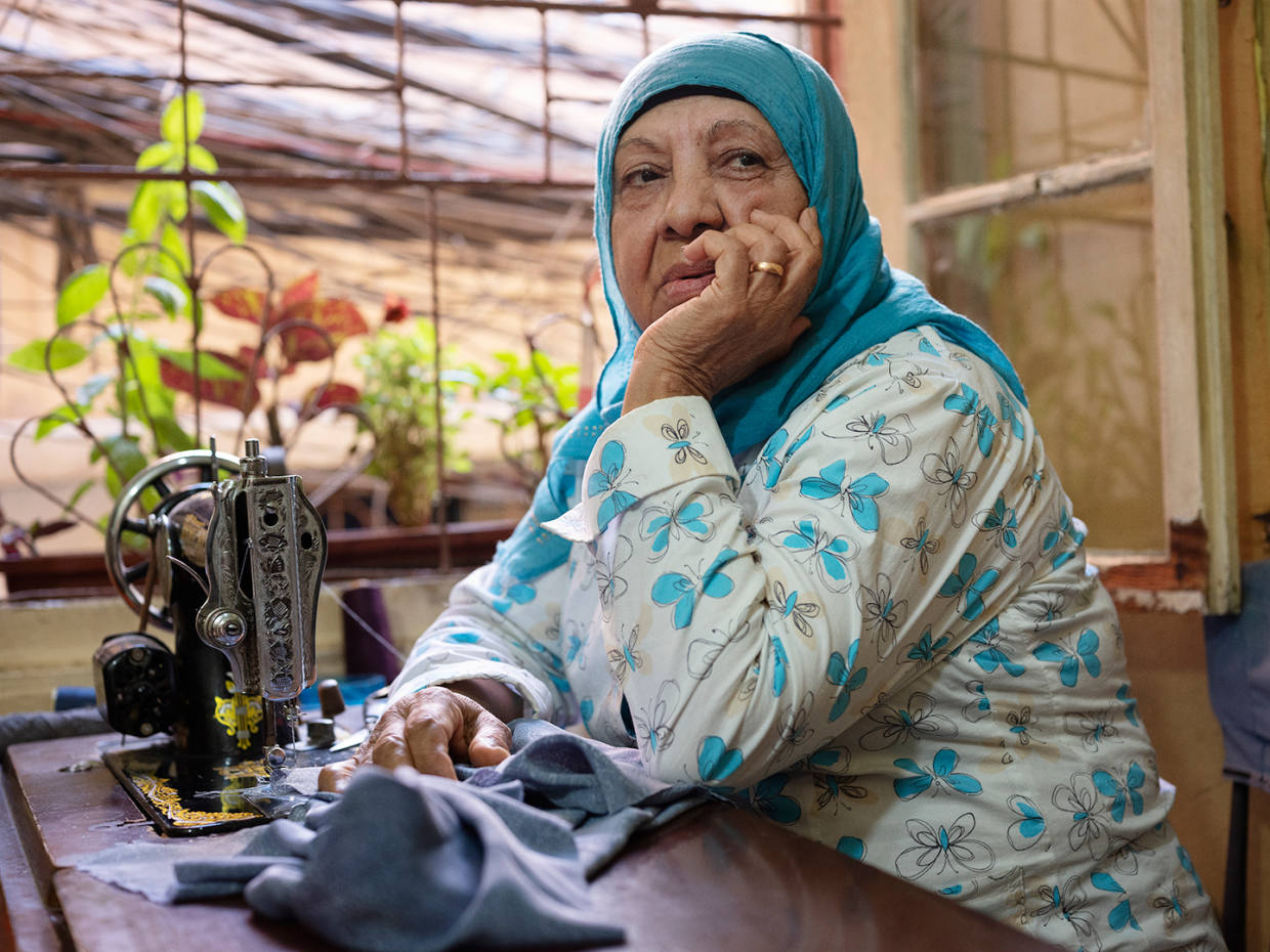 Seamstress in Shatila by Edward Jonkler, part of the Into The Light exhibition at the Royal Opera Arcade Gallery