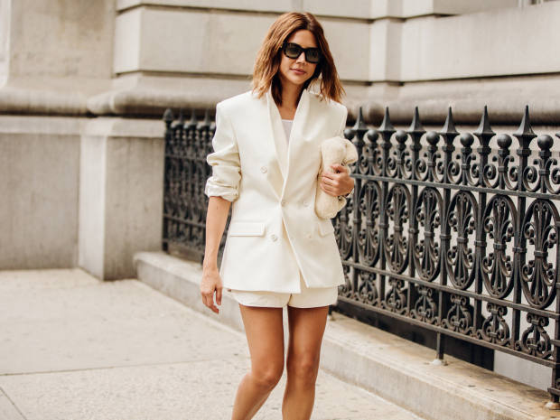 Christine Centenera pairs a Wardrobe.NYC blazer with men's Louis Vuitton shorts and a Jil Sander bag