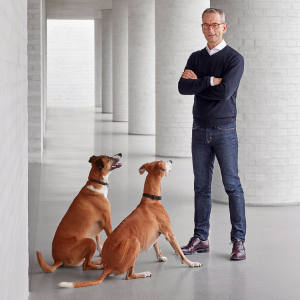 Mike Spink with two of his Lurchers at his David Chipperfield-designed home in the Chilterns