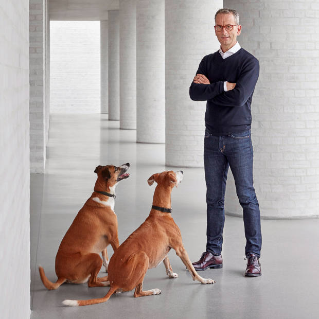 Mike Spink with two of hisLurchers at his David Chipperfield-designed home in the Chilterns