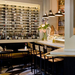 Mont Bar comes complete with marble counter, polished brass rail and a row of stools