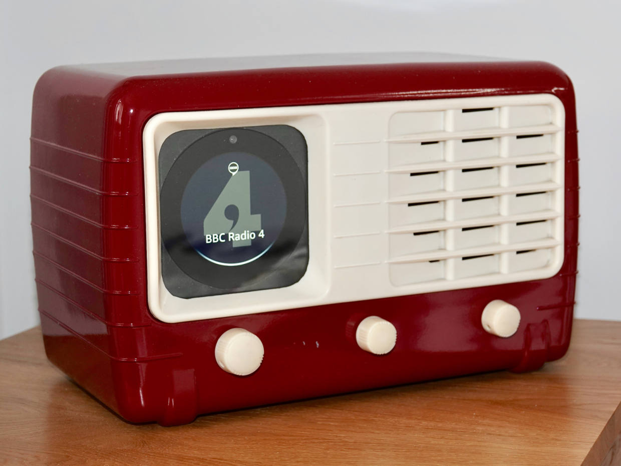 A restored Ultra radio, dating from 1947, incorporating heating, light and sound controls and finished in Balmoral red
