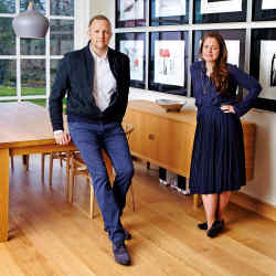 Stefan Turnbull and art dealer Lyndsey Ingram, with a series of etchings from A Rake's Progress, 1961-1963, by David Hockney