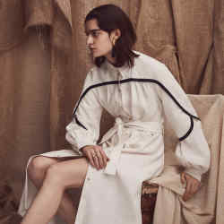 Stella McCartney wool dress, £825. Céline leather sandals, about £500. Slim Barrett gold plated silver and fabric tassel earring, £390 for pair