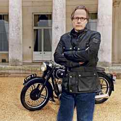 Charles March in front of Goodwood House, wearing the new Gordon version of the Trialmaster jacket, £550, from the Goodwood Sports & Racing by Belstaff collection, with a 1935 AC car designed by his grandfather and a 1936 BMW R5 motorbike