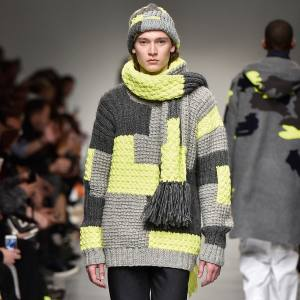 From left: Emporio Armani wool-mix blouson, £570. Raf Simons handknitted wool jumper, £555. Dries Van Noten wool‑mix jumper, £625