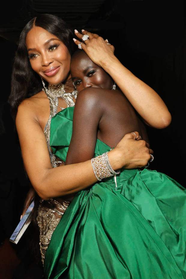 Naomi Campbell, in Bulgari and Asprey, and Adut Akech, backstage at the 2019 Fashion Awards