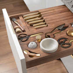 Lanserring's foraging drawer, similar from £1,500, was sculpted down to the millimetre to house a keen forager's tools