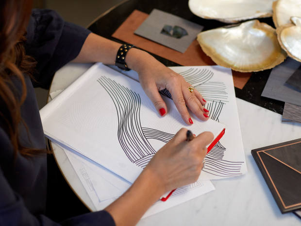Swirling hand-drawn lines run throughout the design