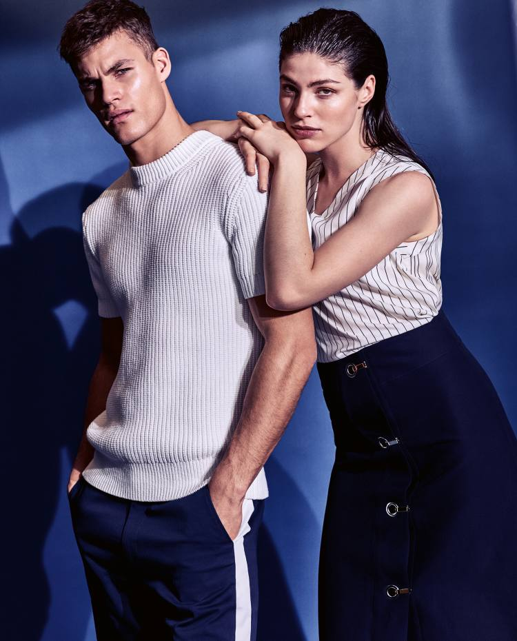 He wears Michael Kors techno-cotton jumper, £120, and cotton gabardine trousers, £160. She wears Brunello Cucinelli silk vest, £890. Marni cotton skirt, £820
