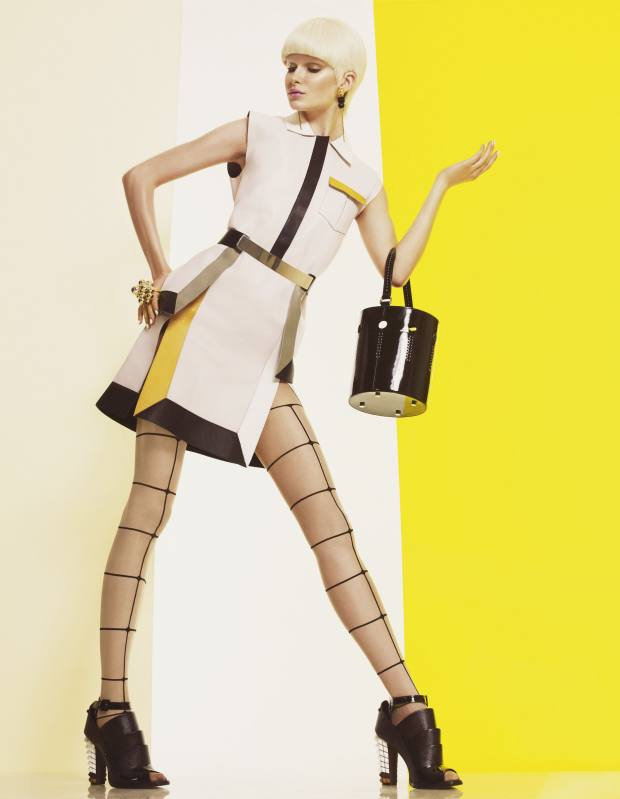 Leather dress, £2,300, and leather shoes, £980, both by Fendi. Metal and leather belt, £30, by Aqua by Aqua. Nylon-mix tights, £33, by Wolford. Patent leather bag, €1,050, by Perrin Paris 1893. Metal and bead earrings, $145, by Laruicci. Lucite bauble ring, $162, by Circa Sixty Three