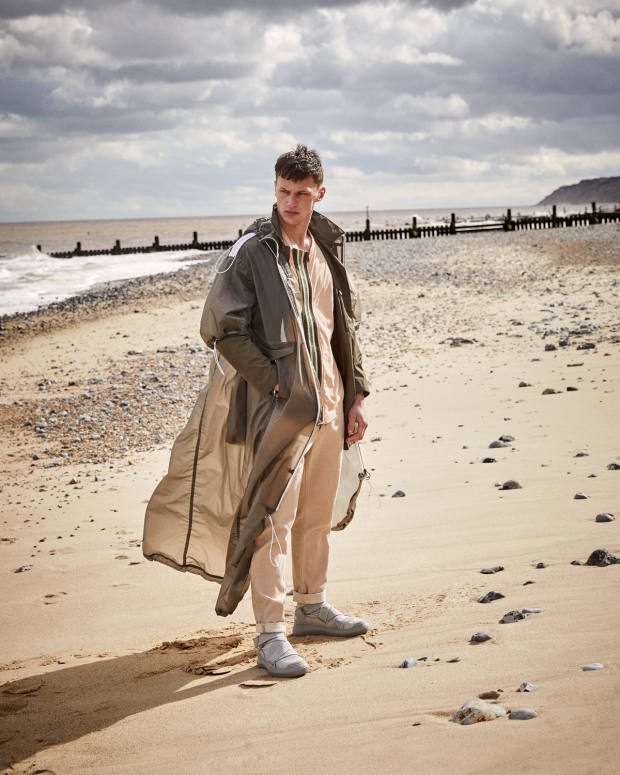 EA7 Emporio Armani PVC coat, price on request. Corneliani double-faced techno chiffon coat, £610. DSquared2 cotton jersey T-shirt, £350. Stone Island cotton trousers, £215. Emporio Armani nubuck, grosgrain and elastic boots, £420