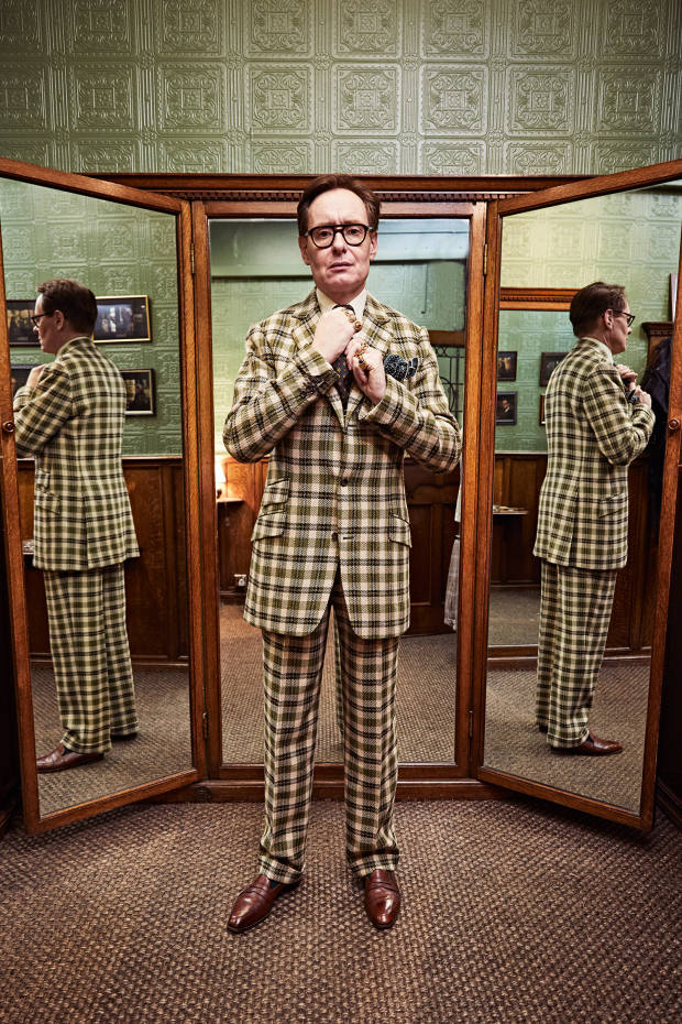 With the bold check cloth tweaked to his exact requirements, Foulkes tries on his new suit