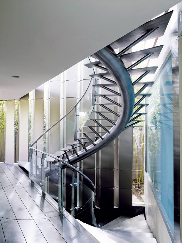 Curves such as a spiral staircase soften the linear profiles at Crescent House