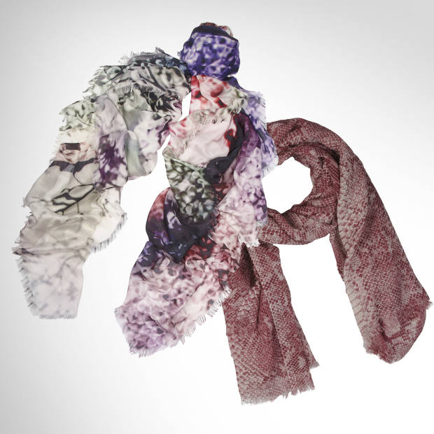 From left: Mary Katrantzou modal and cashmere-blend scarf, £310; Stella McCartney Python Print wool scarf, £240