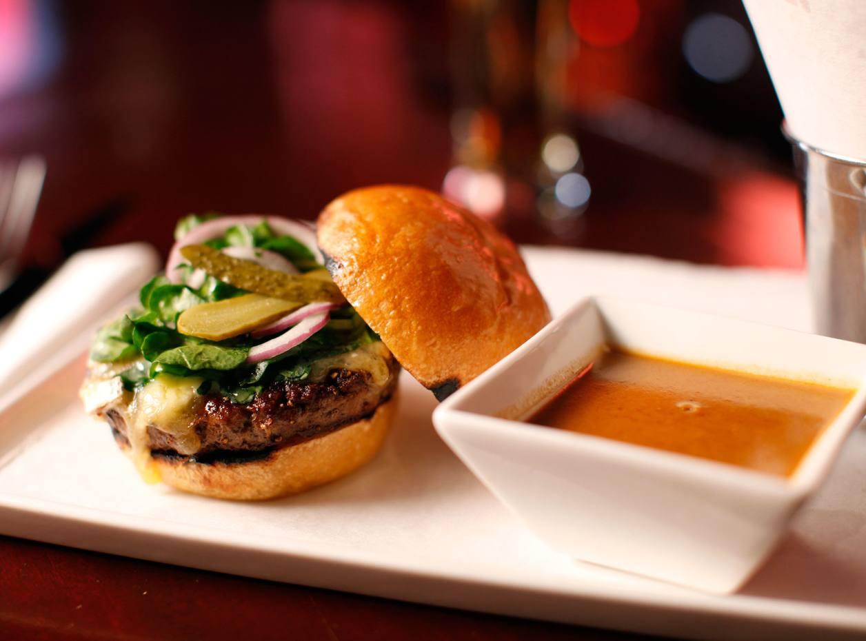 Raoul's au poivre burger served with au poivre sauce and duck-fat fries, $23