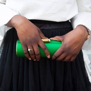 Amanda Pearl duchesse-satin clutch bag, $575, and enamel and pearl ring, $122