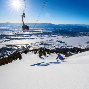 A skier on the Grand Run at Jackson Hole, beneath the resort's Doppelmayr Teton quad lift