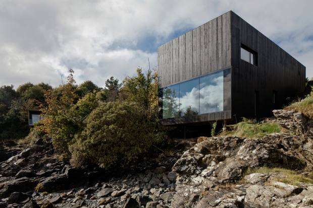 Dualchas' design cantilevers on rocks above the Sound of Sleat