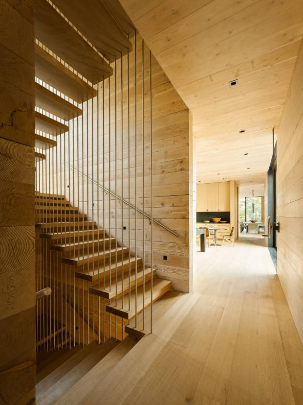 The staircase in Teton House, where the interiors are set to a backdrop of rift-cut oak, fir and walnut