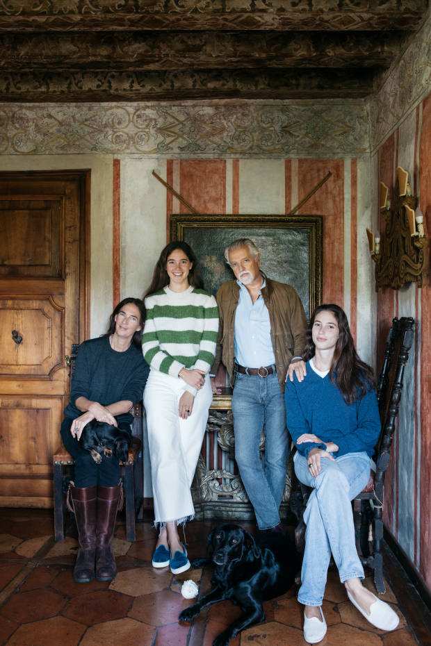 Giberto Arrivabene Valenti Gonzaga with (from left) his wife Bianca, their daughters Vera and Malfada and dogs Bricola the Dachshund and Dushka the Labrador at Castelletto di Pedeguarda