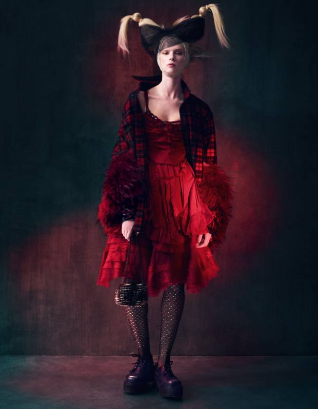 Raccoon-fur gilet, £1,595, by Amanda Wakeley. Wool check shirt, £590, and mesh and crystal fishnet tights, £675, both by Saint Laurent by Hedi Slimane. Silk dress, £3,800, and silk top (worn over top of dress), £1,055, both by Nina Ricci. Leather shoes with metal studs on heel, £189, by Underground London. Leather studded Sweet Charity bag, £795, by Christian Louboutin
