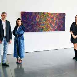 Adrián and Colette Steckel and Simonida Pavicevic (far right) at The House of Fine Art gallery, Los Angeles, with Spring Mews by Zhuang Hong Yi