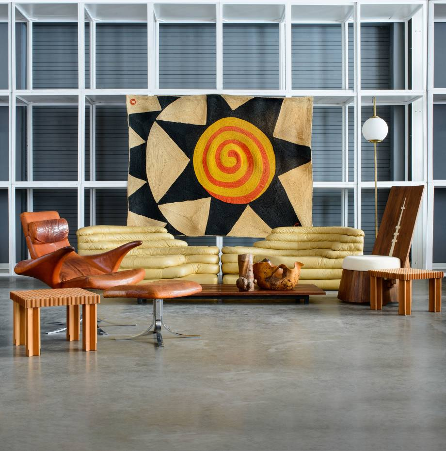 Chen's eclectic collection includes this Star, After Alexander Calder tapestry ($6,000-$8,000), a Xue Wenjing chair ($3,000-$5,000, pictured right) from the Wood Attack Collection, a Seagull lounge chair and ottoman ($15,000-$20,000, pictured left) and a pair of Terrazza settees ($10,000-$15,000)