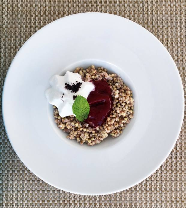 A breakfast of organic buckwheat with whipped coconut cream and strawberry compote