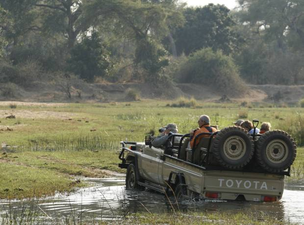 Baines' River Camp guests on a game drive