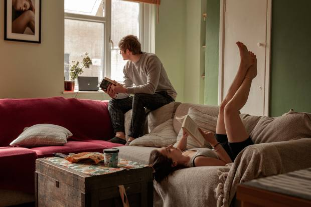 """Luce Lapadula, London: """"I'm sending you a picture that captures the way I'm spending the quarantine in a shared house with my flatmate, Misha. Reading books, eating ice cream, watching movies and relaxing."""""""