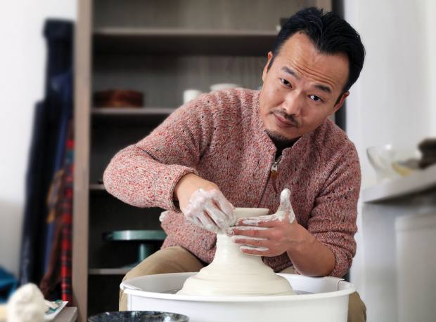 Ishii making pottery for the restaurant