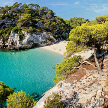 """Cala Macarelleta, Menorca. """"The beaches are the mostamazing in the Mediterranean,"""" says Roméede Goriainoff of Experimental Group, which opens its latest hotel on theisland this summer"""