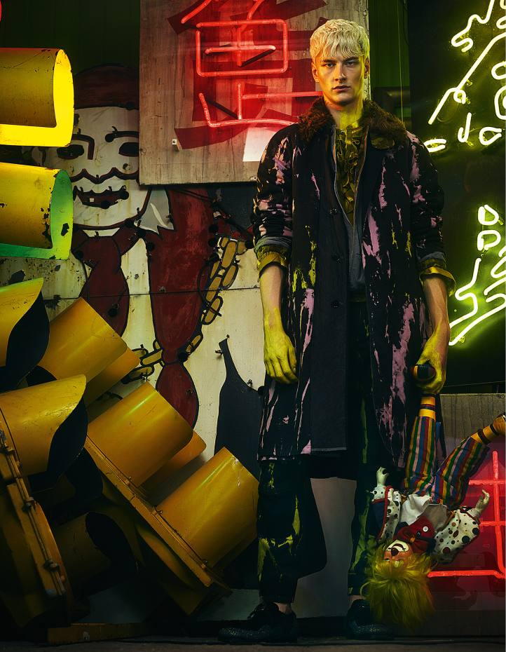 Dries Van Noten cotton-mix coat, £1,067, cotton jacket with shearling collar, £682, cotton shirt, £230, and cotton trousers, £603. Dolce & Gabbana leather shoes, about £730 American traffic lights, and neon sign from the film Tomb Raider, both price on request, from God's Own Junk Yard